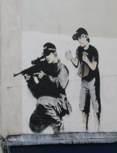 Banksy Police Child